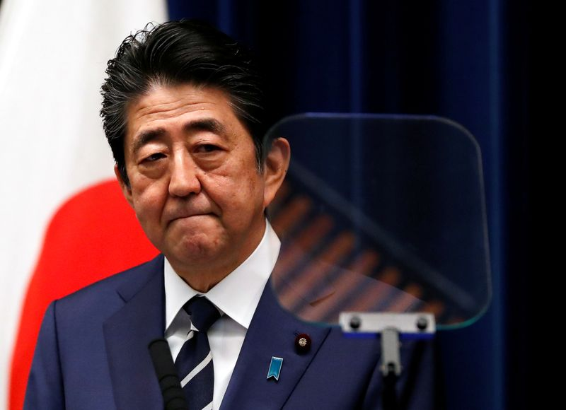 Japan's Abe says ready to top up fiscal spending if virus hits economy