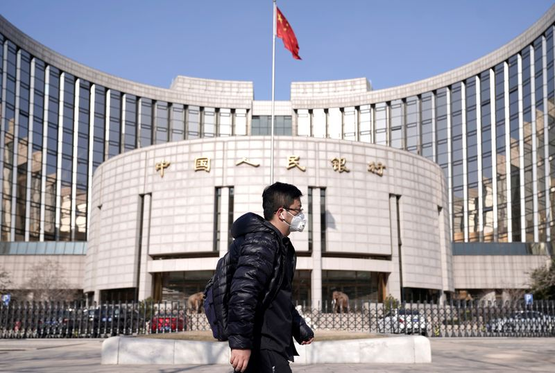 China's central bank keeps short-term rates steady despite Fed easing