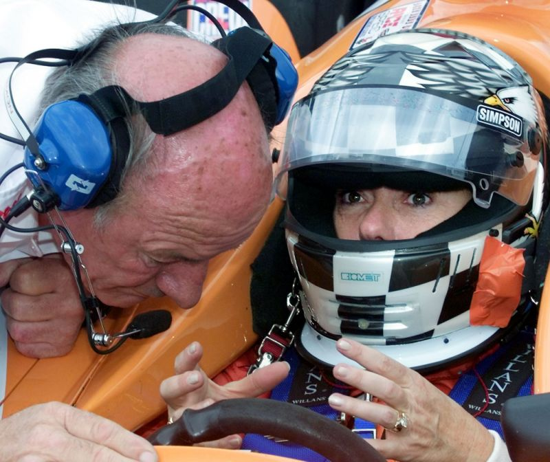Lyn St. James (R) of the US talks with team owner Dick Simon during a rain delay 16 May, 2000, at a practice session for the Indianapolis 500 auto race at the Indianapolis Motor Speedway in Indianapolis. Simon will try to qualify three cars in the Indy 500 to be held on 28 May, 2000. (JEFF HAYNES/AFP via Getty Images)