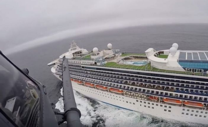 In this image from video, provided by the California National Guard, a helicopter carrying airmen with the 129th Rescue Wing flies over the Grand Princess cruise ship off the coast of California Thursday, March 5, 2020.