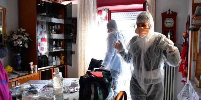 Medical staffers wearing protective gear, part of a special unit performing house calls, work in Bergamo, northern Italy, one of the areas worse-affected by coronavirus, Wednesday, March 25, 2020.