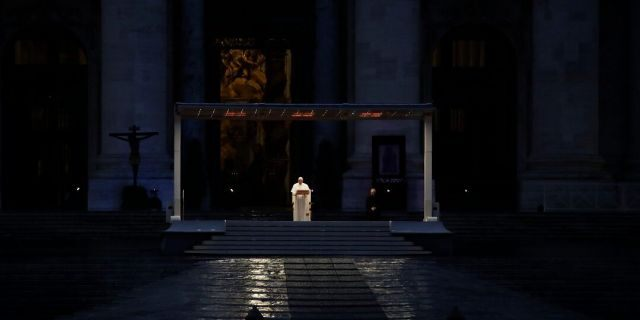 "Pope Francis delivers the Urbi and Orbi prayer (Latin for To the City and To the World) in an empty St. Peter's Square, at the Vatican on Friday. Praying in a desolately empty St. Peter's Square, Pope Francis on Friday likened the coronavirus pandemic to a storm laying bare illusions that people can be self-sufficient and instead finds ""all of us fragile and disoriented"" and needing each other's help and comfort. (AP Photo/Alessandra Tarantino)"