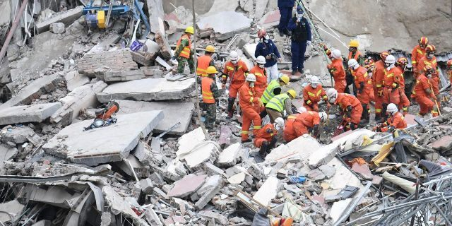 The death toll increased to 20 on Tuesday, with 10 still missing, as rescuers continue searching the rubble. (Lin Shanchuan/Xinhua via AP)
