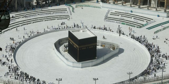 Few worshippers were allowed to enter the Grand Mosque in Mecca after dawn prayers on Saturday to circumambulate the Kaaba over fears of coronavirus. (AP Photo/Amr Nabil)