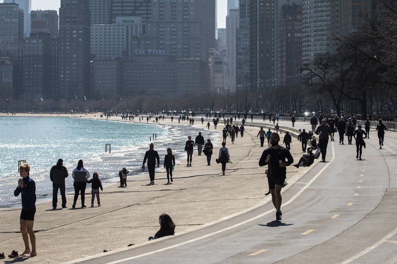 Despite a stay-at-home order from Gov. J.B. Pritzker, people walk, jog and enjoy the lakefront Wednesday afternoon.