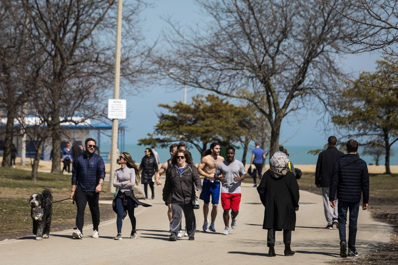 Chicagoans enjoy the warm weather near North Avenue Beach, Wednesday afternoon.