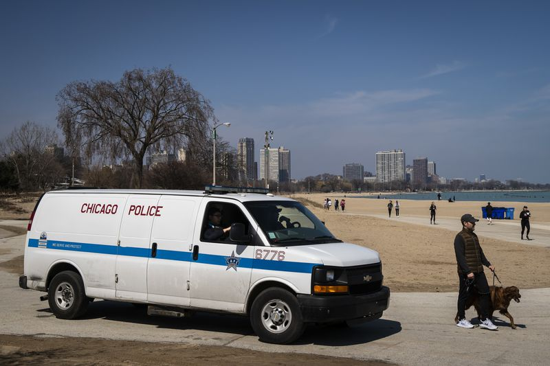 Chicago Police patrol near North Avenue Beach as hundreds could be seen enjoying warm weather along the lakefront Wednesday afternoon.