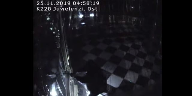 Thieves with torches and tools break into one of the display cabinets in Green Vault museum in Dresden, Germany, November 25, 2019 in this still image taken from a security video. Saxony Police Department/Handout via REUTERS
