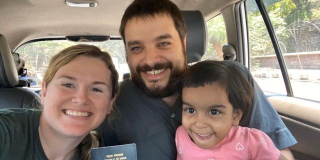 Michael and Whitney Saville and their adopted daughter Grace. They are all stuck in India because of the country's coronavirus lockdown.