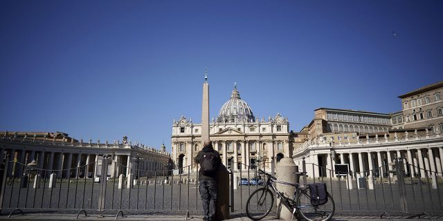 Pope Francis celebrates Palm Sunday without public in St. Peter's