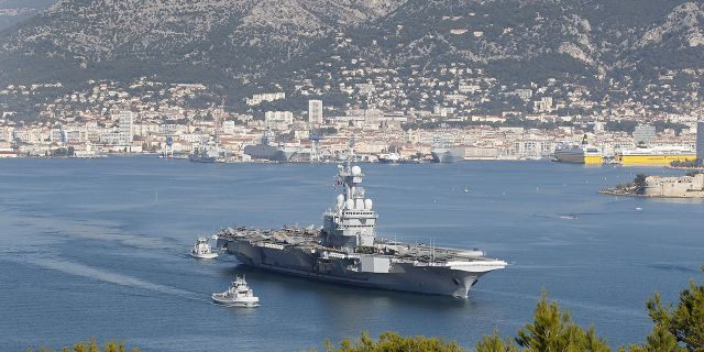 France's defense ministry announced that French aircraft carrier Charles de Gaulle is heading back to port amid possible virus outbreak onboard. (AP Photo/Lionel Cironneau, File)