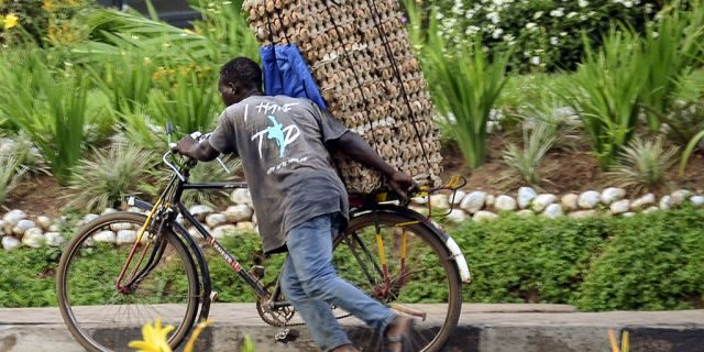 In this photo taken Thursday, March 26, 2020 a man transports cartons of eggs on the back of a bicycle due to restrictions on movement attempting to halt the spread of the new coronavirus, in Kigali, Rwanda. The new coronavirus causes mild or moderate symptoms for most people, but for some, especially older adults and people with existing health problems, it can cause more severe illness or death. (AP Photo)