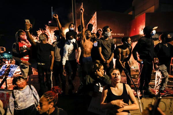Protesters outside the burning police station in Minneapolis on Thursday.