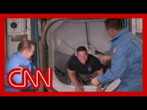 Astronauts disembark SpaceX ship and board space station