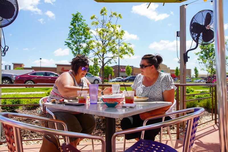 Diners at Chuy's Fine Tex Mex in Orland Park took advantage of the nice weather and the loosened coronavirus restrictions to enjoy a meal on the patio without masks on Friday.