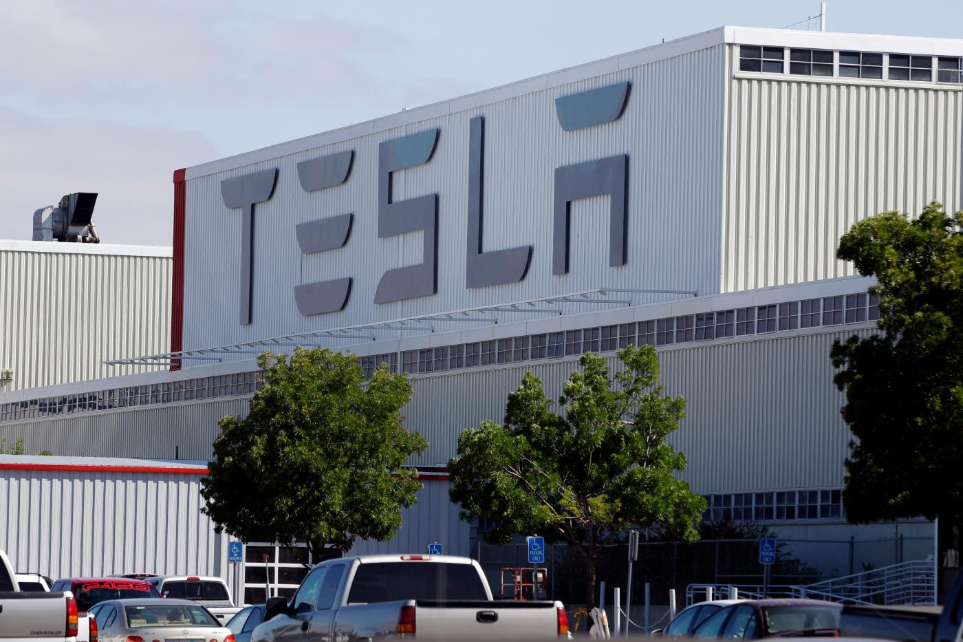 Is Tesla defying county order? With parking lot nearly full, factory looks to be running