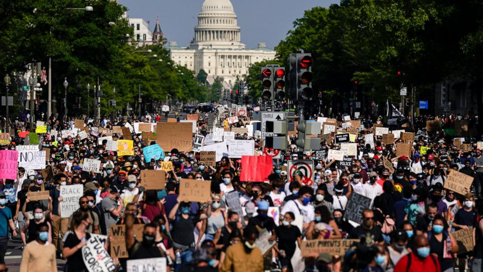 The Latest: Washington protests peaceful amid show of force