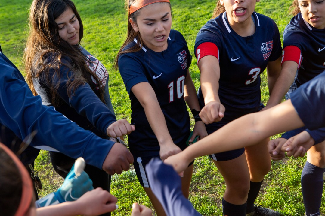Dalia Hurtado, center, during a pregame huddle with her team at Garfield High School in East Los Angeles.