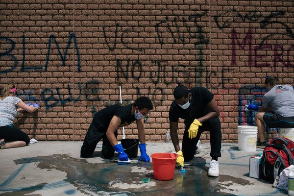In Cities Battered by Protest, the Cleaning Crews Come Out