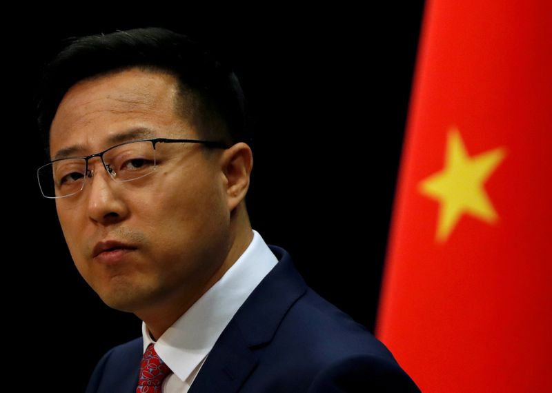 Beijing says it will respond if Washington keeps targeting Chinese media