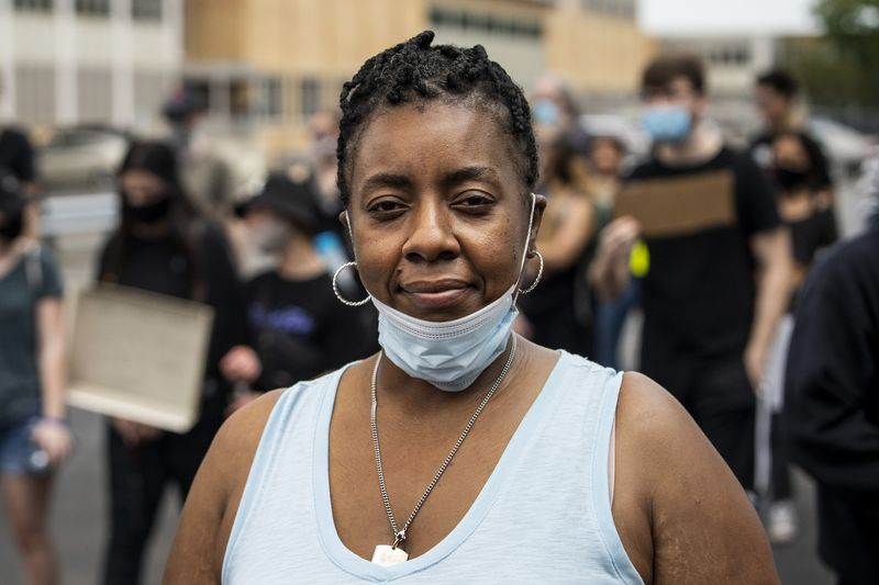 Kimberly Davis, who took part in a Black Lives Matter rally and march Thursday through her Southwest Side neighborhood.