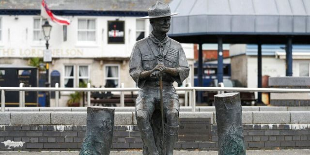 "A statue of the founder of the Scout movement Robert Baden-Powell on Poole Quay in Dorset, England ahead of its expected removal to ""safe storage"" following pressure to remove it over concerns about his alleged actions while in the military and ""Nazi sympathies"" Thursday June 11, 2020. (Andrew Matthews/PA via AP)"