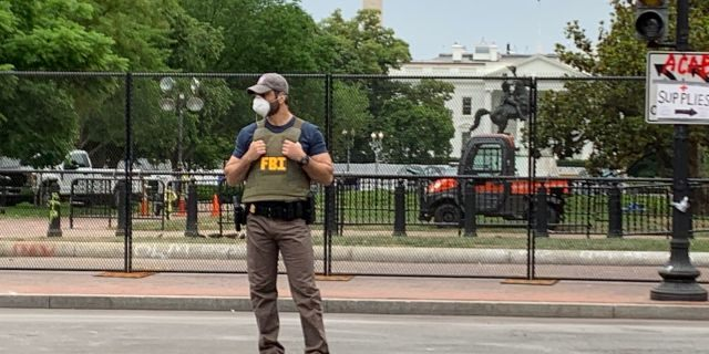 FBI agent guarding the area outside the White House after days of protests that turned violent. (Mark Meredith/FNC)
