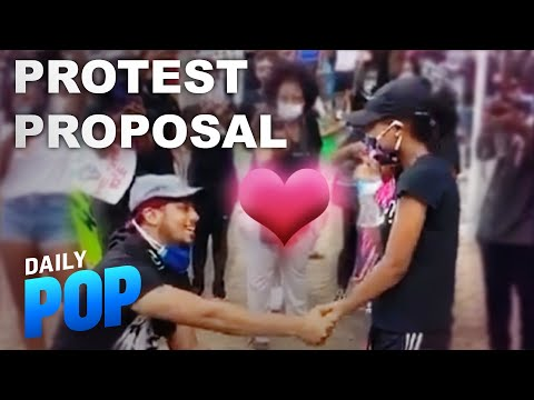 Black Lives Matter Protest Backdrop for Couple's Proposal   Daily Pop   E! News