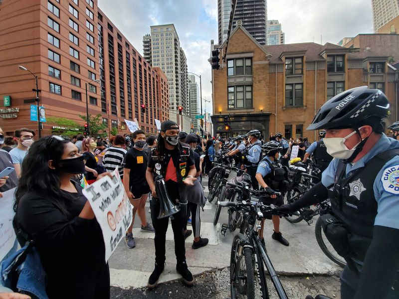 Protesters and Chicago police officers during a march downtown Friday over the death in Minneapolis police custody of George Floyd.
