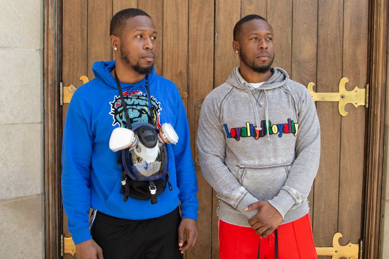 Corey Griffin (left) and his twin brother Chris Griffin after a demonstration Thursday in Auburn Gresham.