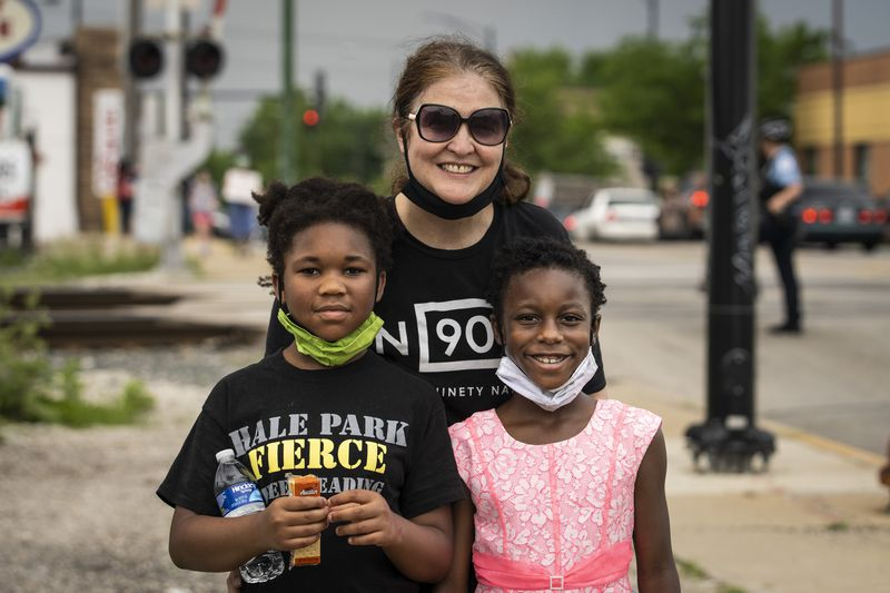 Bernadette O'Shea and her two daughters Lena and Kamariia at a Black Lives Matter rally and march Thursday through their neighborhood on the Southwest Side.