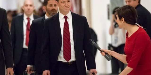 """FILE - In this June 27, 2018, file photo, Peter Strzok, the FBI agent facing criticism following a series of anti-Trump text messages, walks to gives a deposition before the House Judiciary Committee on Capitol Hill in Washington. Strzok, whose anti-Trump text messages fueled suspicions of partisan bias will tell lawmakers July 12 that his law enforcement work has never been tainted by political considerations and that the intense congressional scrutiny of him represents """"just another victory notch in Putin's belt,†according to prepared remarks obtained by The Associated Press.(AP Photo/J. Scott Applewhite, File)"""
