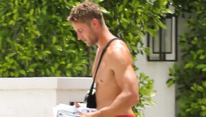 Justin Hartley Shows Off Nasty Injury With Arm In Sling While Walking Shirtless Outside His House