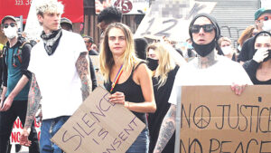 Cara Delevingne, MGK & Travis Barker Protest & Hold Empowering Signs Together In LA
