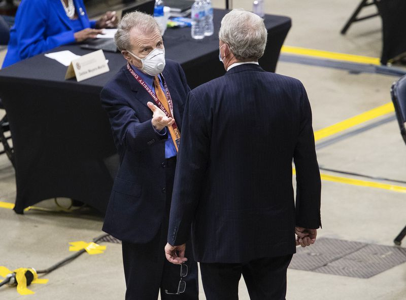 House Speaker Mike Madigan, D-Chicago, left, speaks with Illinois House Minority Leader Jim Durkin, R-Western Springs, on the floor of the Bank of Springfield Center in Springfield,