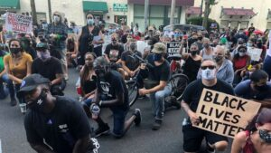 Protest after cop uses knee to restrain man