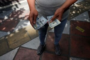 Currency crisis impoverishes Iranians, strains economic defenses