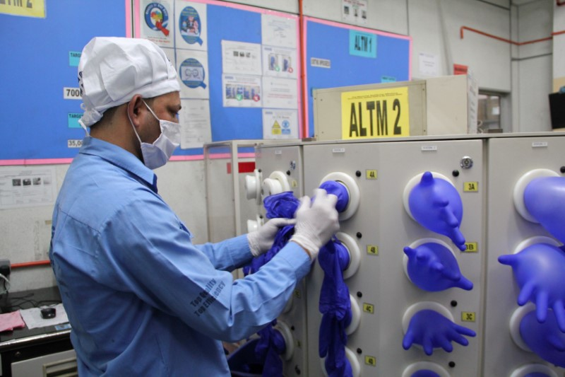 Amid virus crisis, U.S. bars imports of Malaysia's Top Glove over labor issues