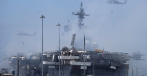 While Navy Warship Burns, Sailors Are Forced to Bail Water