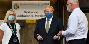 Boris Johnson says Britons 'should be wearing face masks in shops' amid coronavirus