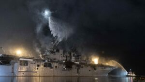 Navy warship burning 4th day shows difficulty of ship fires