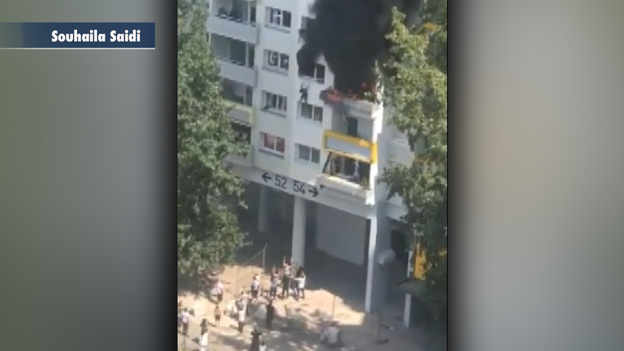 French children dropped from burning apartment building to Good Samaritans in dramatic moment caught on video