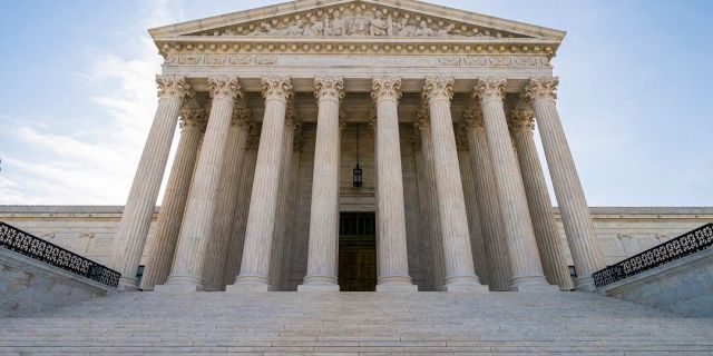 Thought the Supreme court is not doing its business in person during the pandemic, it's been called on multiple times to rule on efforts to halt states' coronavirus restrictions. (AP Photo/J. Scott Applewhite)