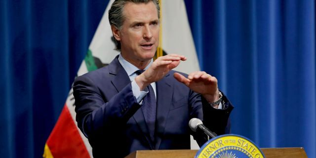 In this May 14, 2020, file photo, California Gov. Gavin Newsom discusses his revised 2020-2021 state budget during a news conference in Sacramento, Calif. Gov. Gavin Newsom announced Friday, July 17, 2020, that most counties will start the school year online due to soaring coronavirus cases and hospitalizations, but counties that have seen little of the virus, mostly towns and rural communities in California's north and east can bring students and teachers back to campus. (AP Photo/Rich Pedroncelli, Pool, File)