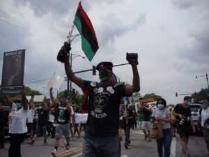 Protesters march through Bronzeville after police block them from Dan Ryan