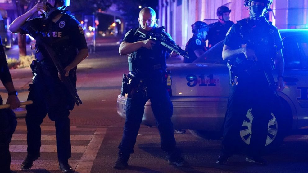 The Latest: Crews clean up after protests in Louisville