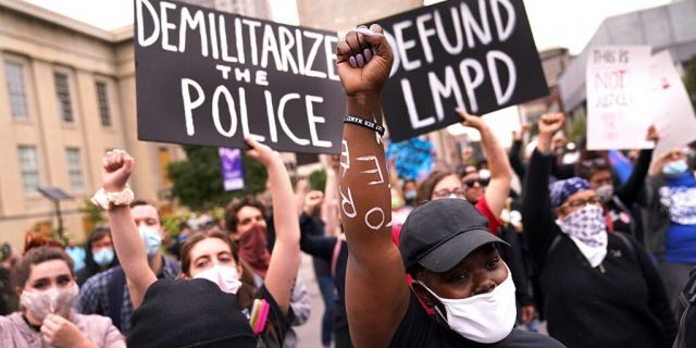 Protesters speak, Wednesday, Sept. 23, 2020, in Louisville, Ky. A grand jury has indicted one officer on criminal charges six months after Breonna Taylor was fatally shot by police in Kentucky. (AP Photo/John Minchillo)