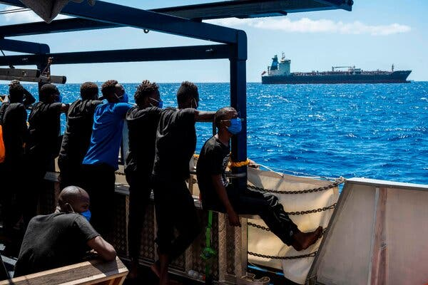 Migrants Rescued by Tanker Arrive in Italy After Weekslong Standoff