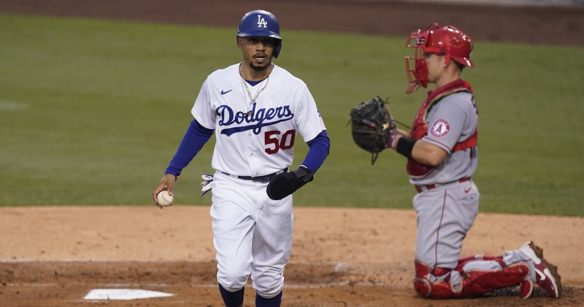 Dodgers' Mookie Betts leaves game after getting hit in side by a pitch