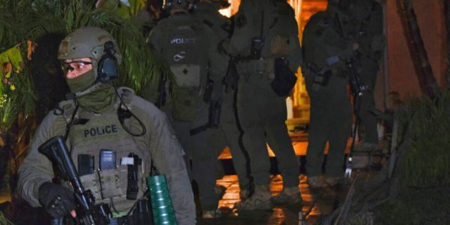 DEA agents search a residential house during an arrest of a suspected drug trafficker on Wednesday, March 11, 2020, in Diamond Bar, Calif. In early-morning raids Wednesday, federal agents fanned out across the U.S., culminating a six-month investigation with the primary goal of dismantling the upper echelon of the Jalisco New Generation Cartel, known as CJNG. (AP Photo/Richard Vogel)